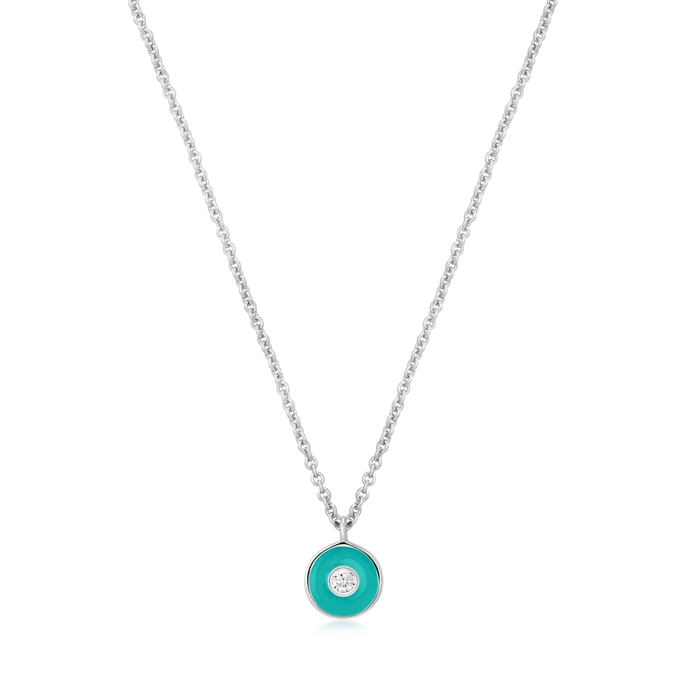 Beautiful dangling necklace showcasing the Om symboled Peace radiating from the necklace which emanates from the wearer.